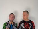 KAMINARI-Trainer Anton Krischer wurde von Ralf Warneking der blaue Gürtel im 10th Planet Jiu Jitsu verliehen